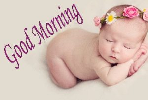 Good morning image with cute baby and a flower