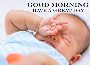 Baby Waking Up Good Morning Have a Great Day Wallpaper